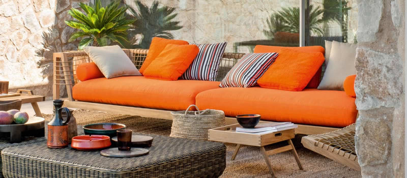 Synthesis Sofa with orange and grey cushions