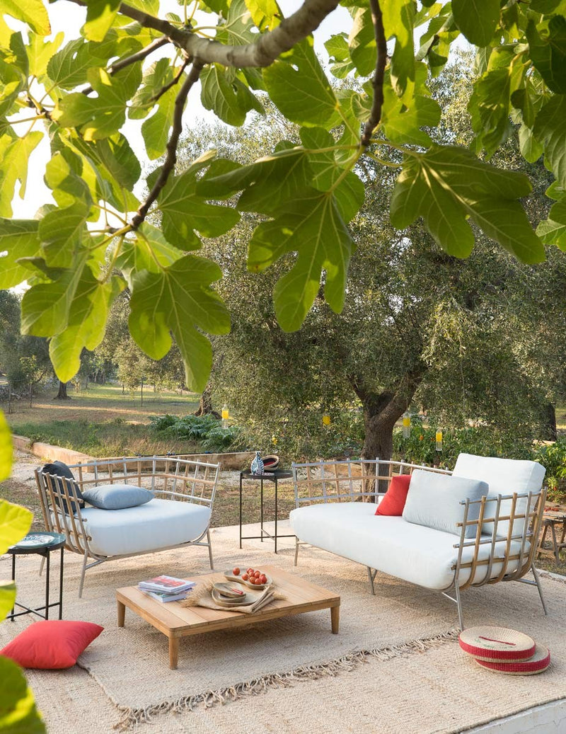 Patio with outdoor Italian furniture and Tweed sofa by Unopiú