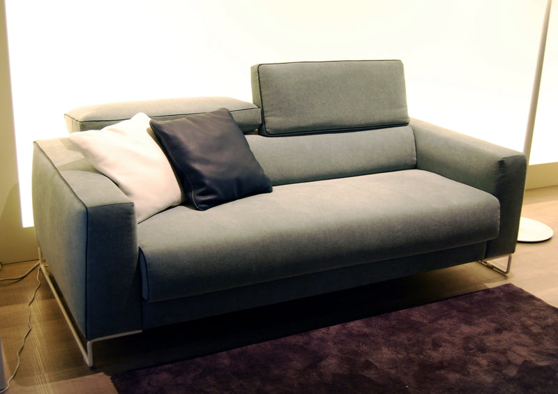 Italian sofa bed in sofa configuration with white and black pillows