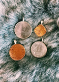 coin pendants from around the  globe.