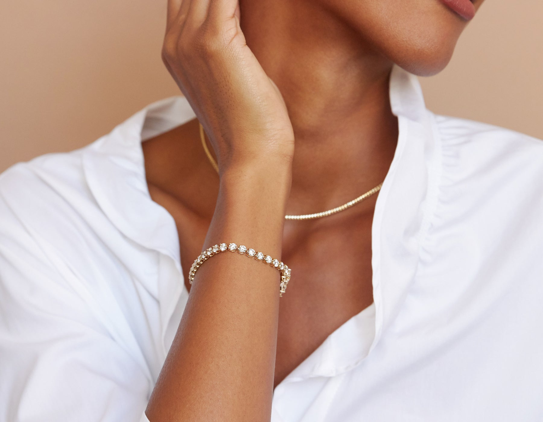 Model wearing elegant minimalist Round Diamond Tennis Bracelet 14k yellow gold, 14K White Gold