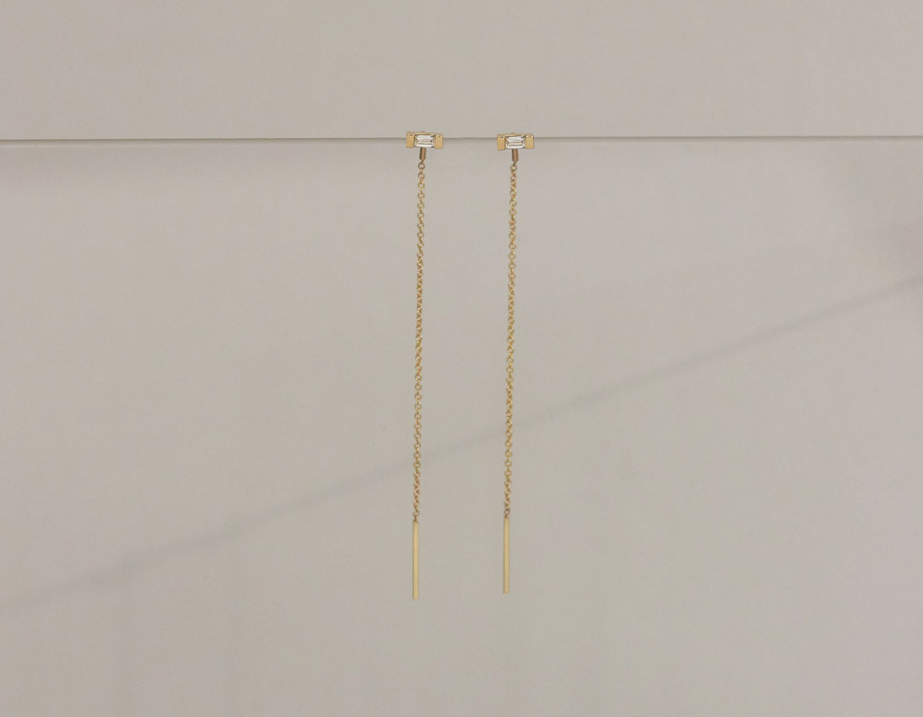 Vrai & Oro 14k solid gold Baguette Diamond Line threaders sustainable minimalist earrings