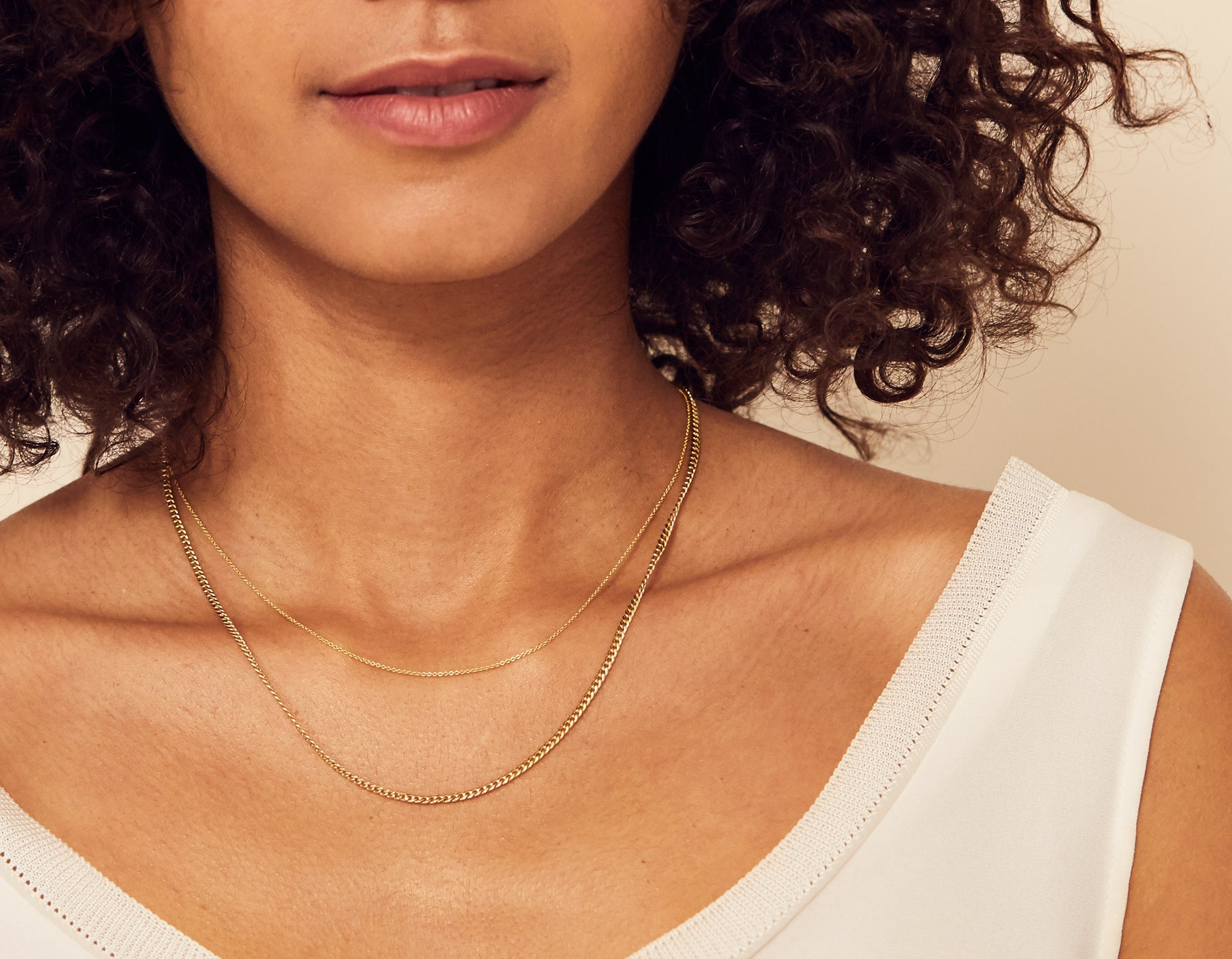 Model wearing thick 14k solid gold Cuban Link Chain Necklace modern minimalist Vrai & Oro