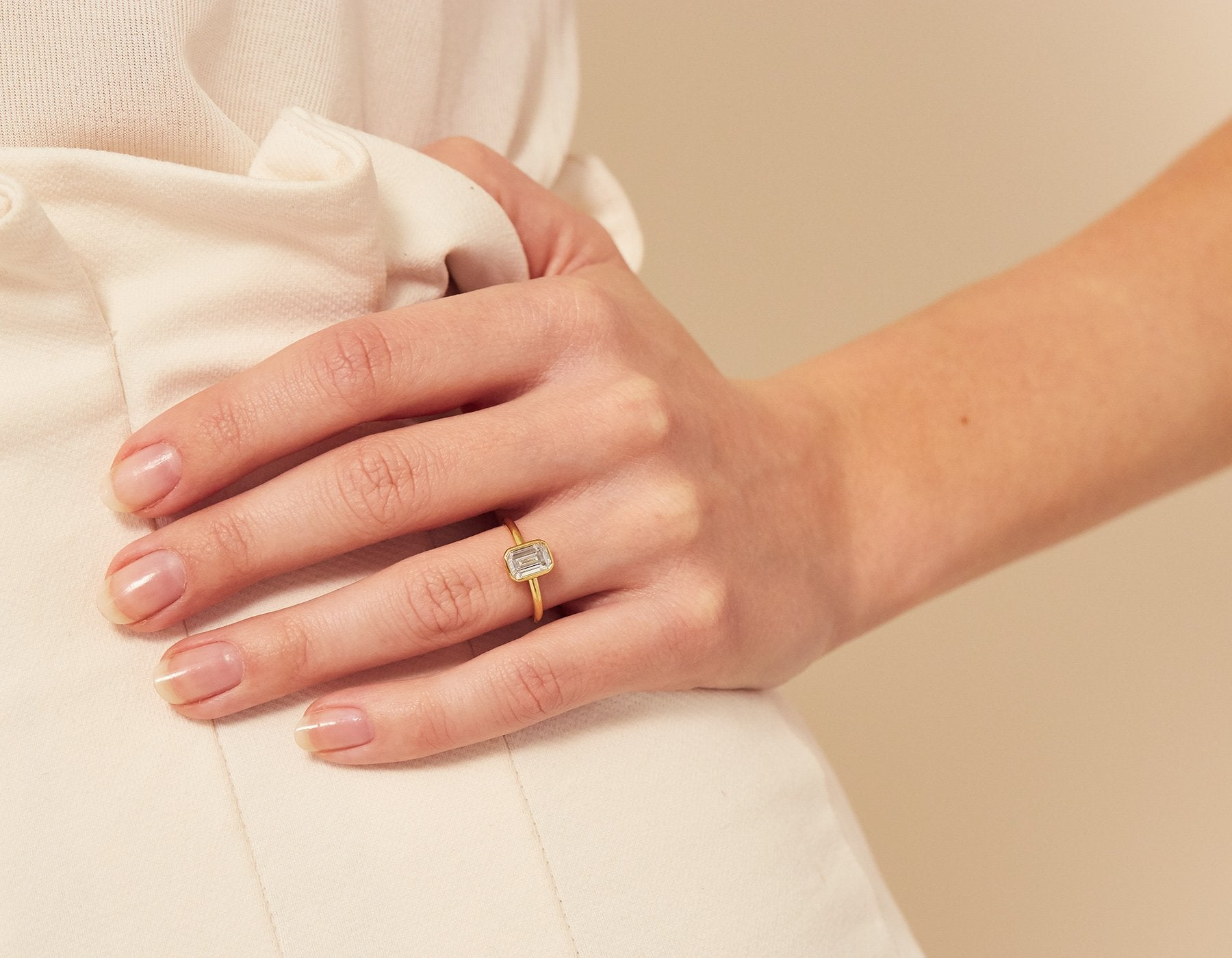 Model wearing Emerald Bezel Diamond Engagement Ring Vrai & Oro Modern minimalist Sustainable diamond foundry