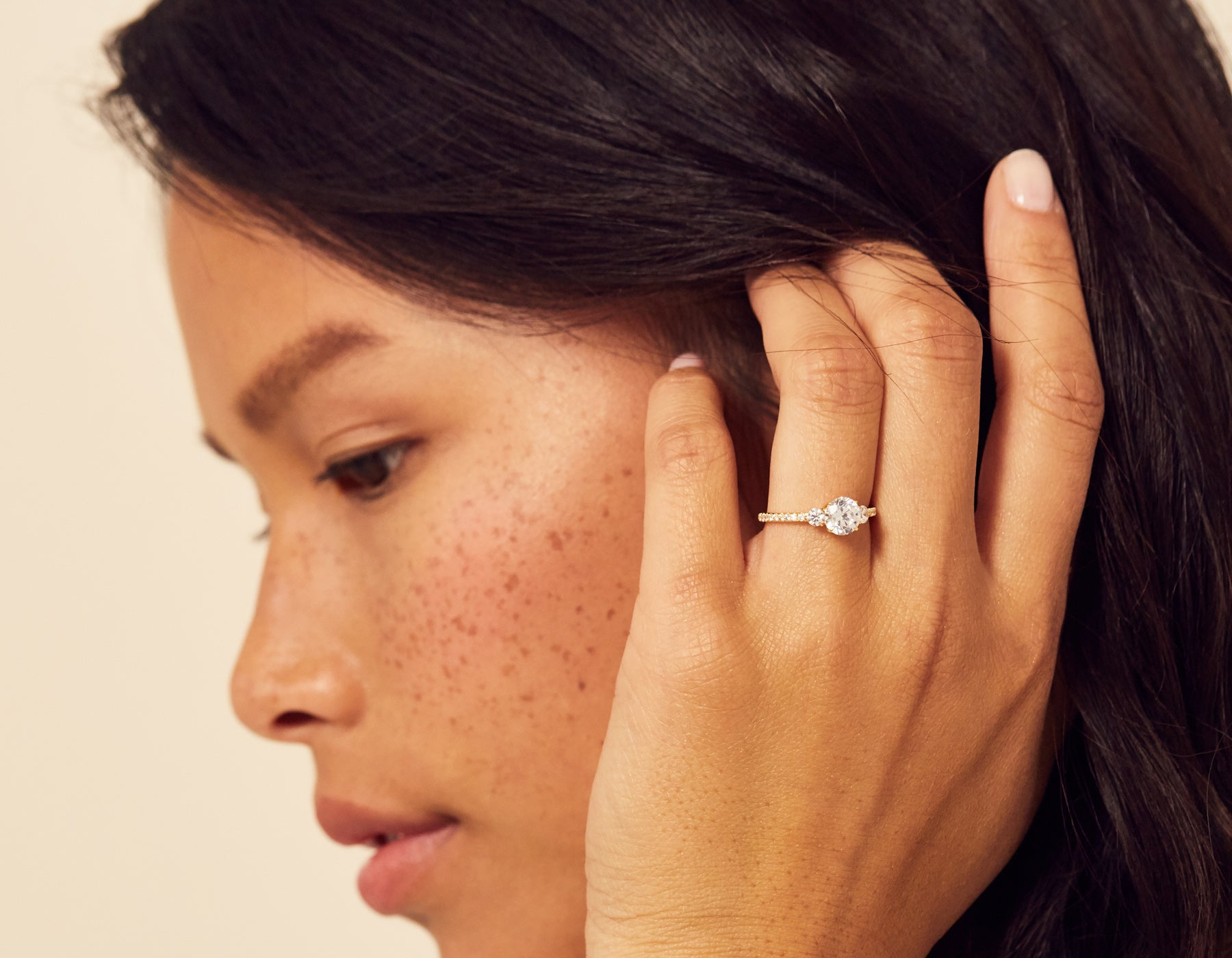 Model wearing Three Stone Pave Diamond Engagement Ring Vrai & Oro Modern minimalist Sustainable diamond foundry