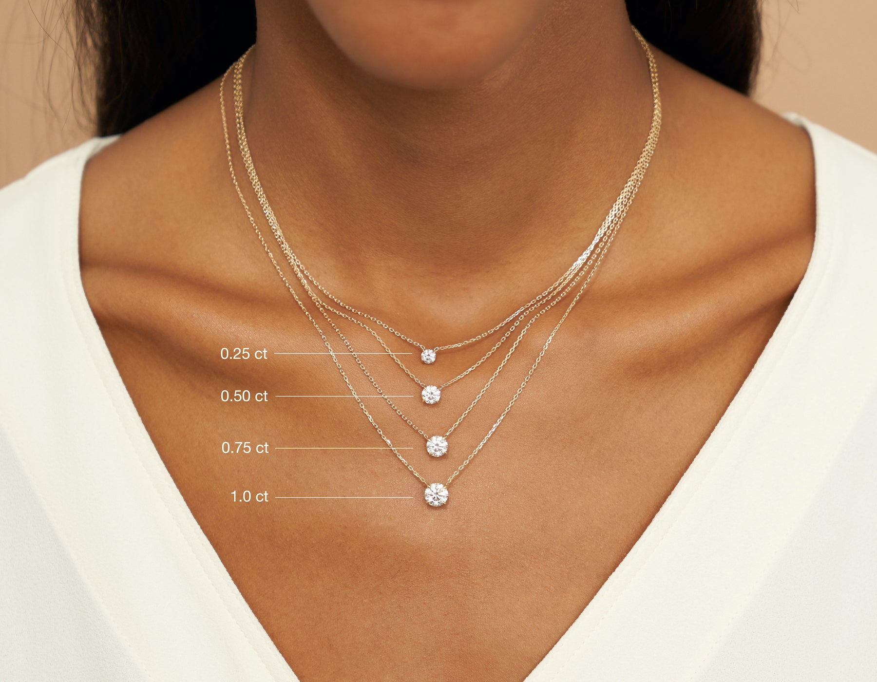 Model wearing Vrai 14K solid gold solitaire round brilliant diamond necklace 1ct .75ct .50 carat .25 carat minimalist simple jewelry