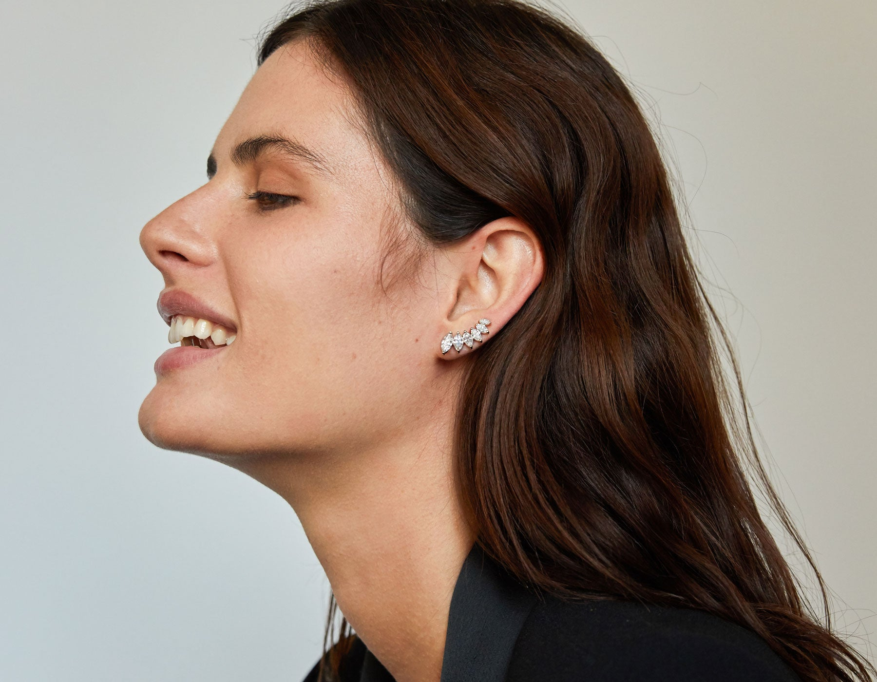 Model wearing minimalist classic 14k gold Marquise Diamond Ear Arc by Vrai
