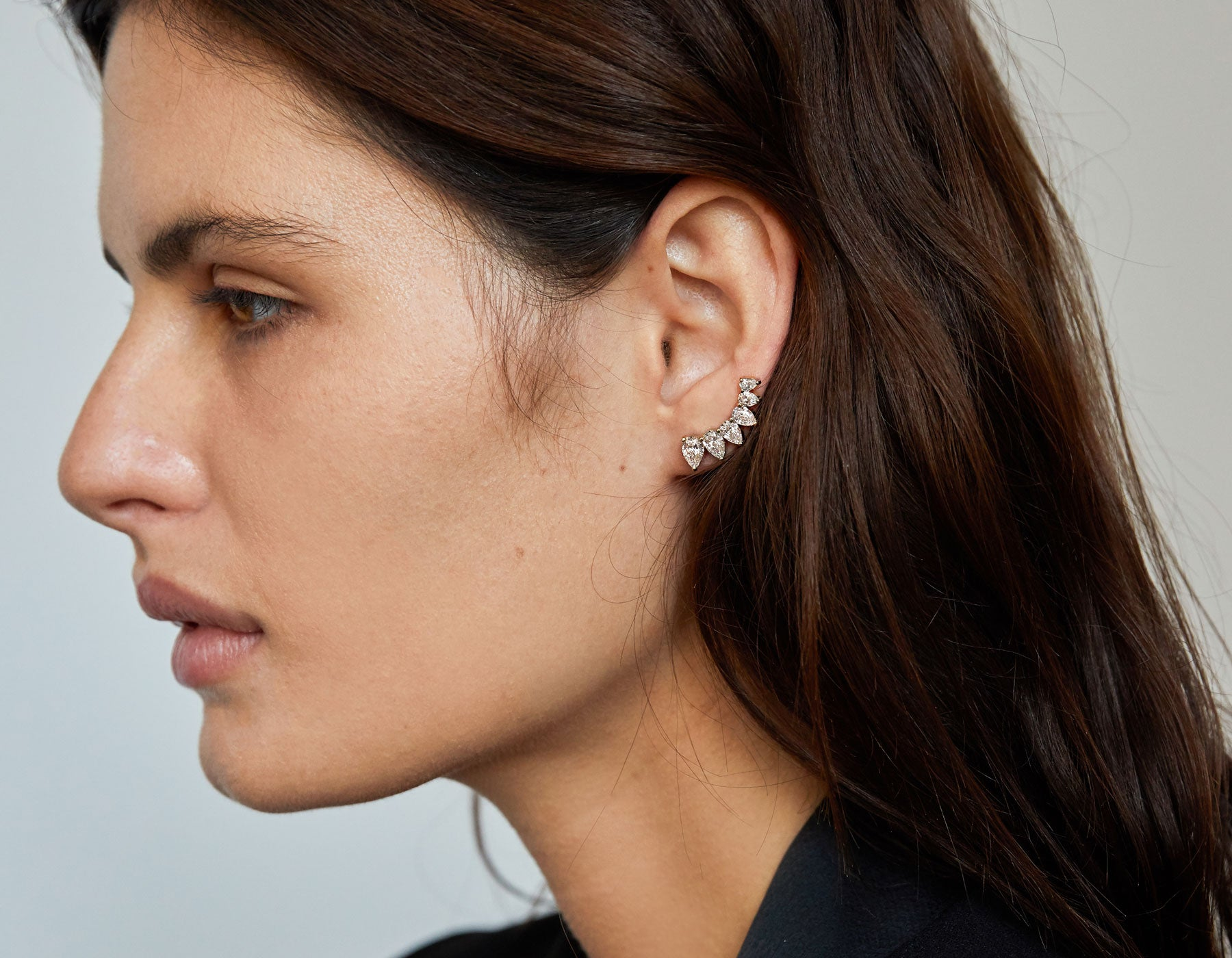 Model wearing minimalist classic 14k gold pear Diamond Ear Arc by Vrai