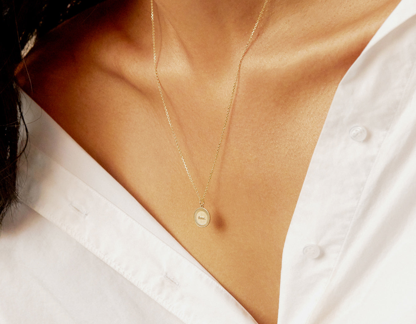 woman modelling 14k solid gold Fem. Necklace dangling female pendant thin chain by Vrai & Oro
