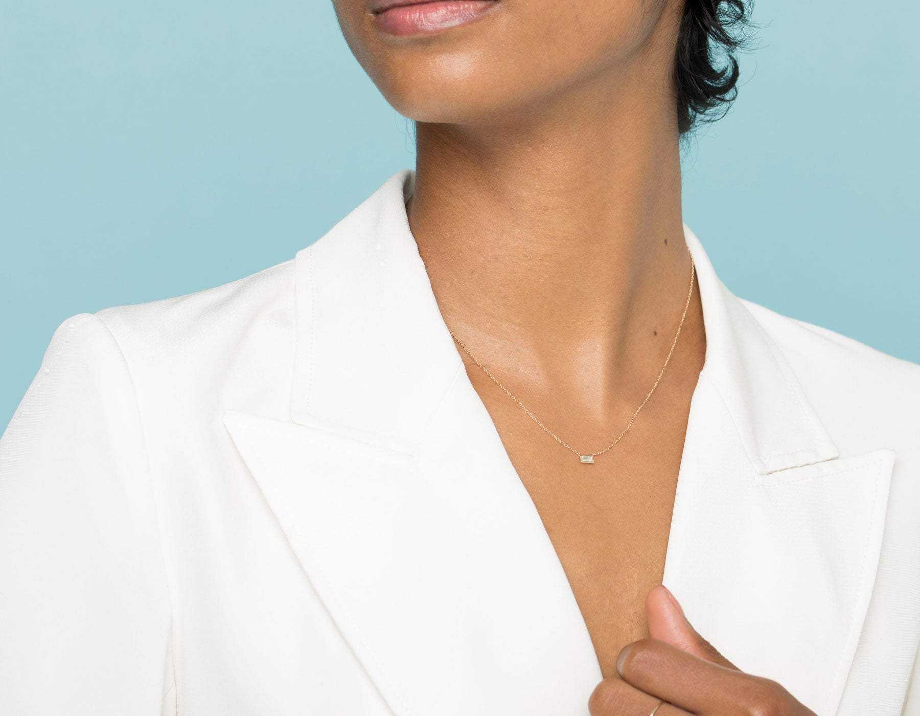 Model wearing dainty minimalist Baguette Diamond Bezel Necklace by Vrai, 14K White Gold