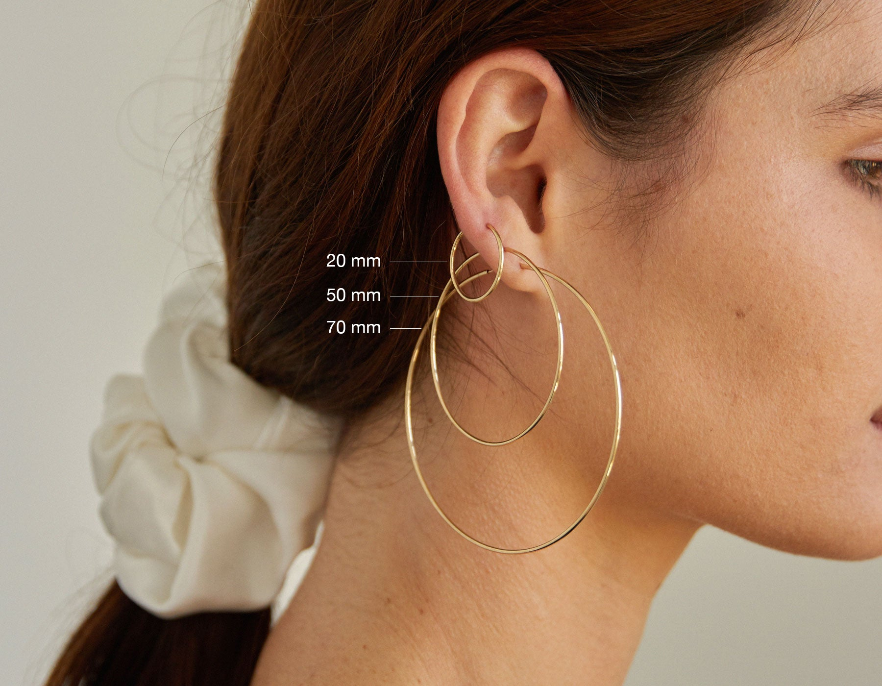 model wearing Vrai simple minimalist large hoop small hoop 14K yellow gold