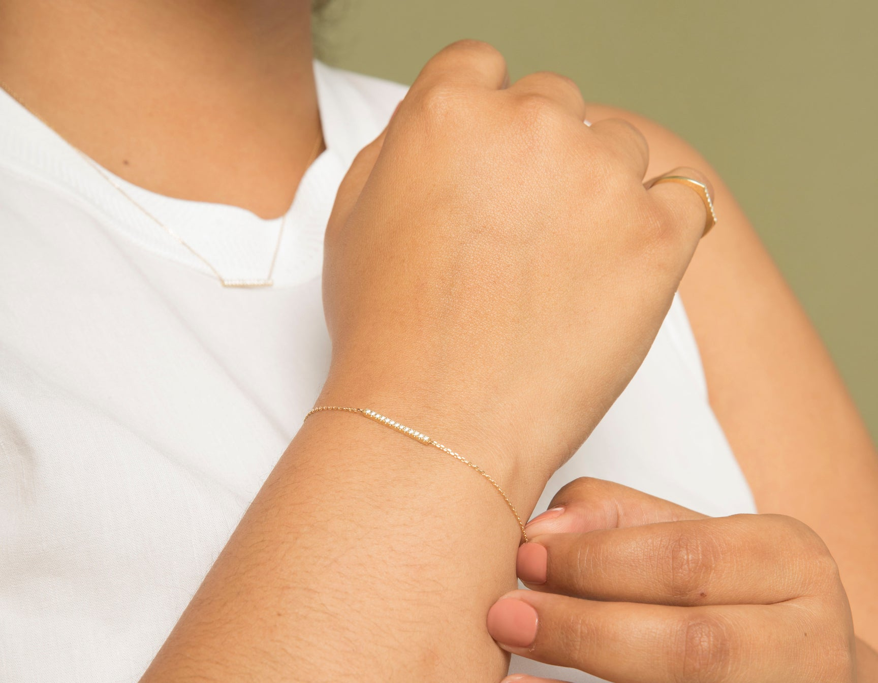 Model wearing sleek Vrai solid gold Line Bracelet with Pave, 14K Yellow Gold