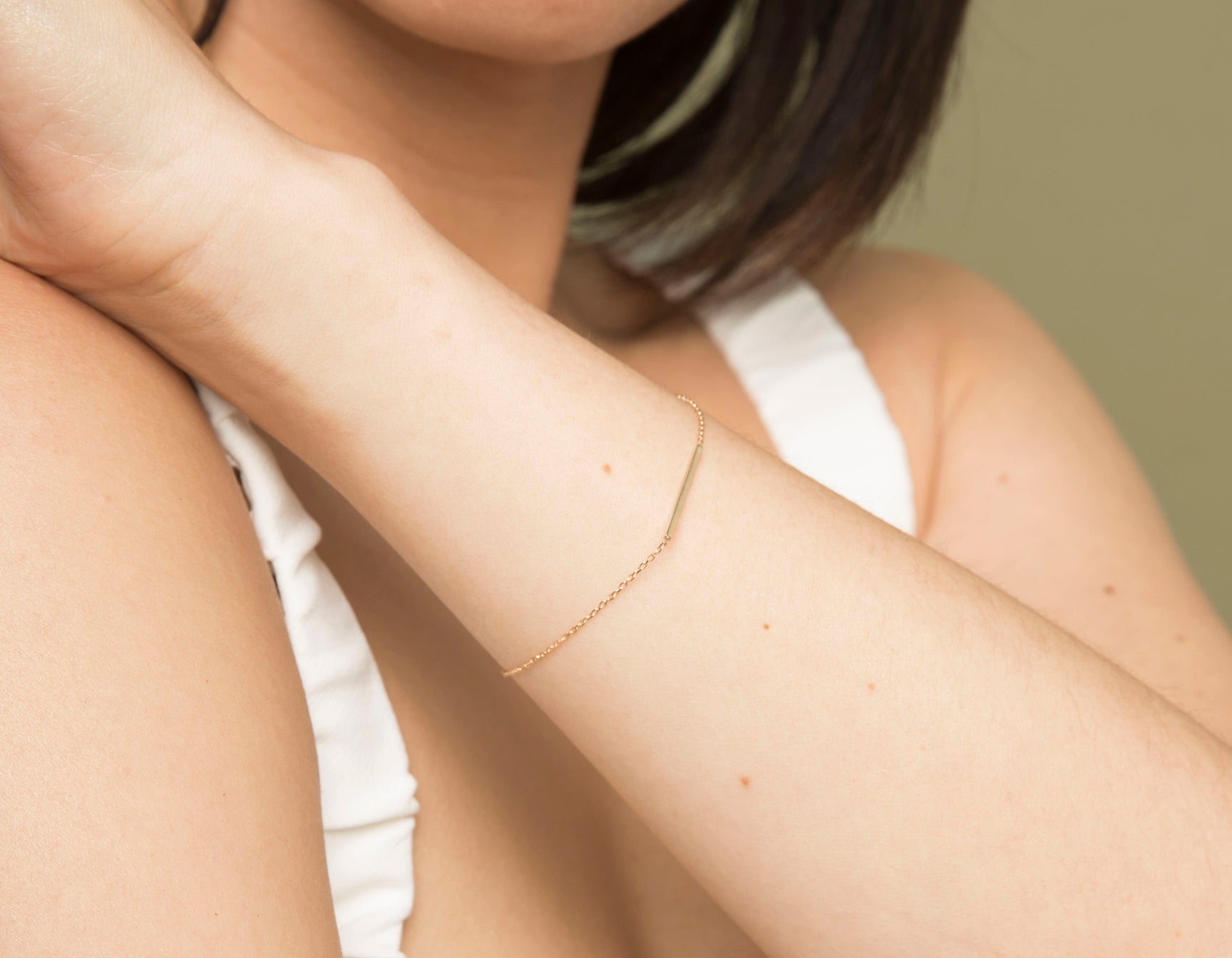 Model wearing sleek Vrai solid gold Line Bracelet, 14K Rose Gold