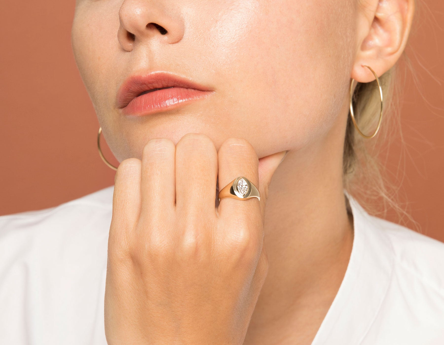 Model wearing Vrai 14k yellow gold Marquise Diamond signet ring