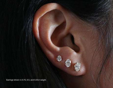 Model wearing Vrai 14k solid gold Solitaire Oval Diamond Studs in various carat weights