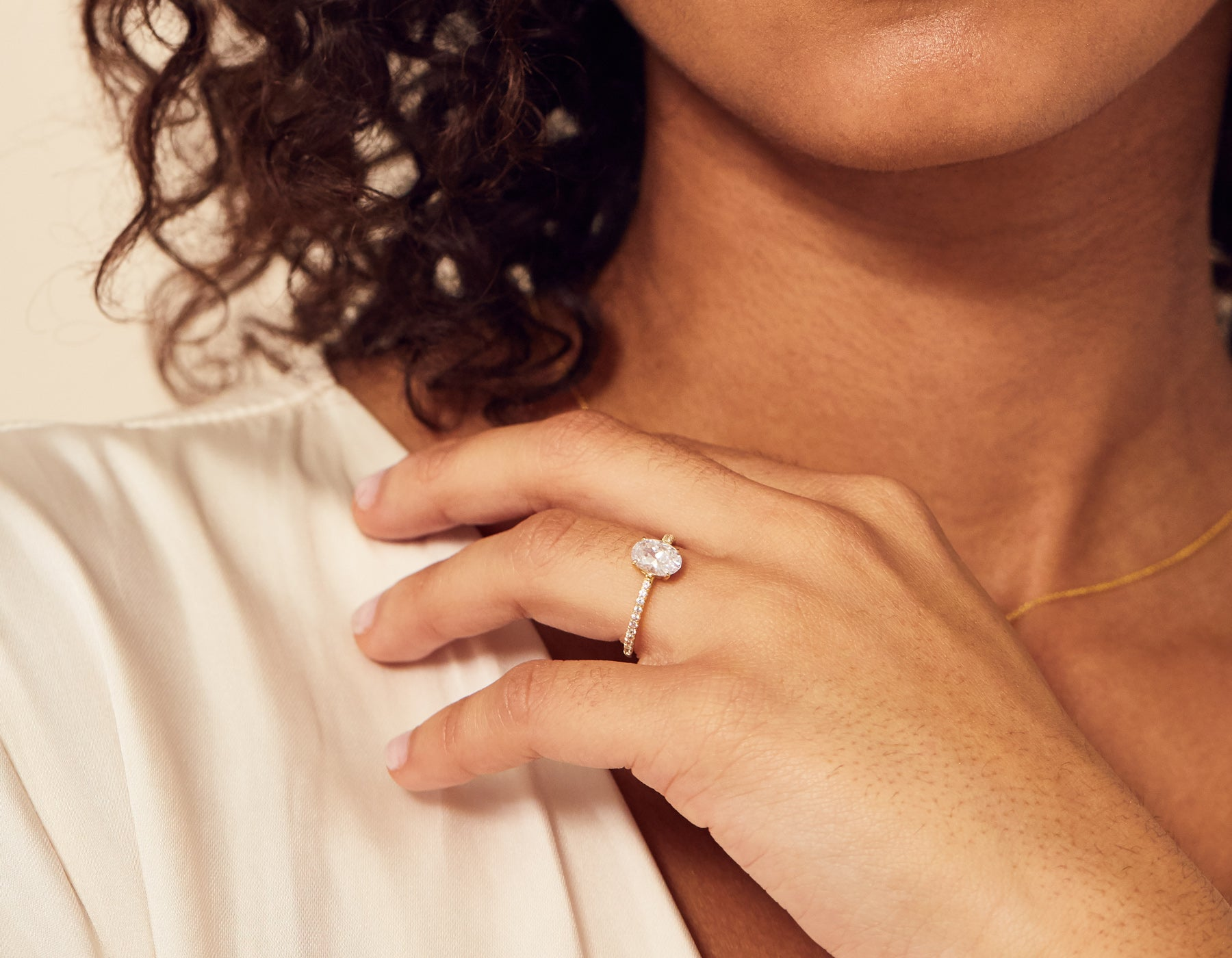 Model wearing Oval Pave Diamond Engagement Ring Vrai & Oro Modern minimalist Sustainable diamond foundry