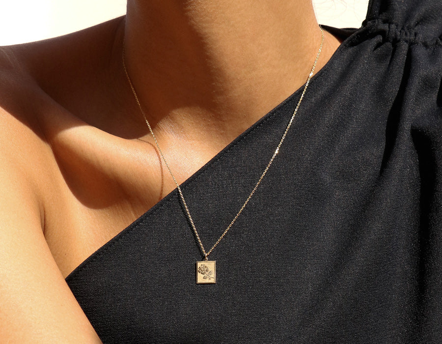 Model wearing Vrai & oro modern classic 14K solid Yellow Gold Rose Pendant Necklace