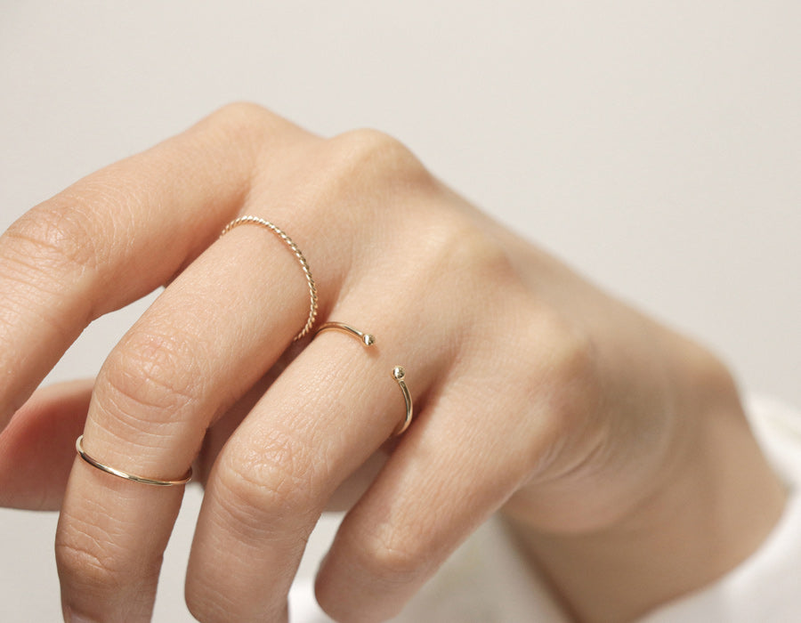 Vrai and oro 14k solid gold Simple stack bundle delicate minimalist rings modelled
