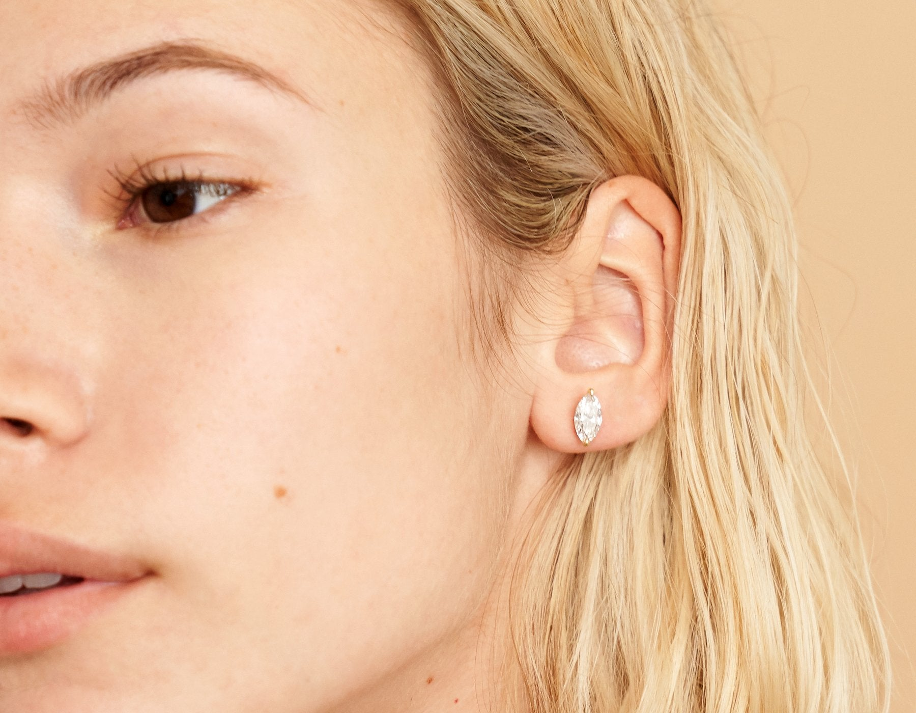 Model wearing Vrai 14K solid gold solitaire marquise diamond studs earrings 1ct minimalist delicate, 14K Yellow Gold