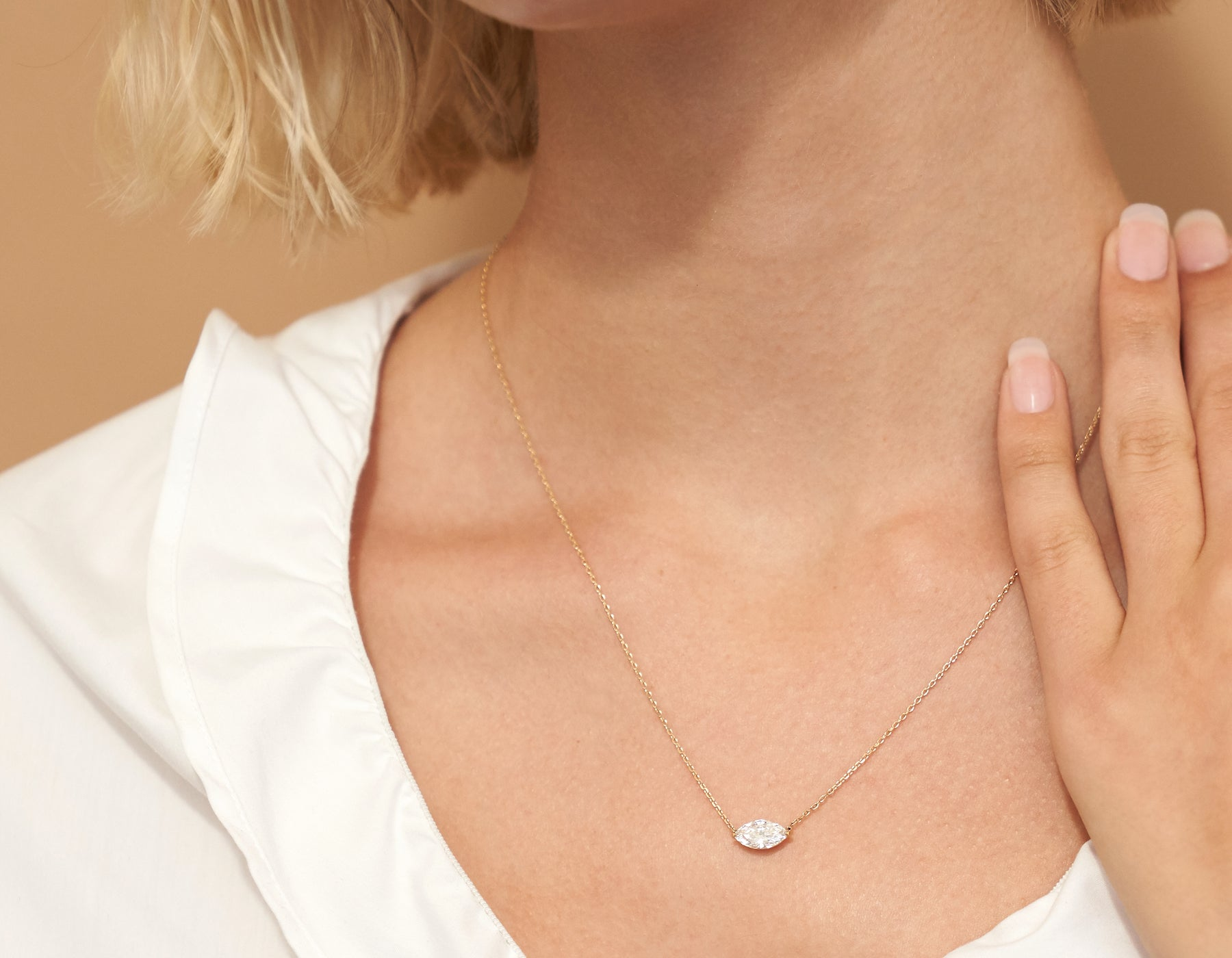 Model wearing Vrai 14K solid gold solitaire marquise diamond necklace 1ct minimalist delicate, 14K Rose Gold