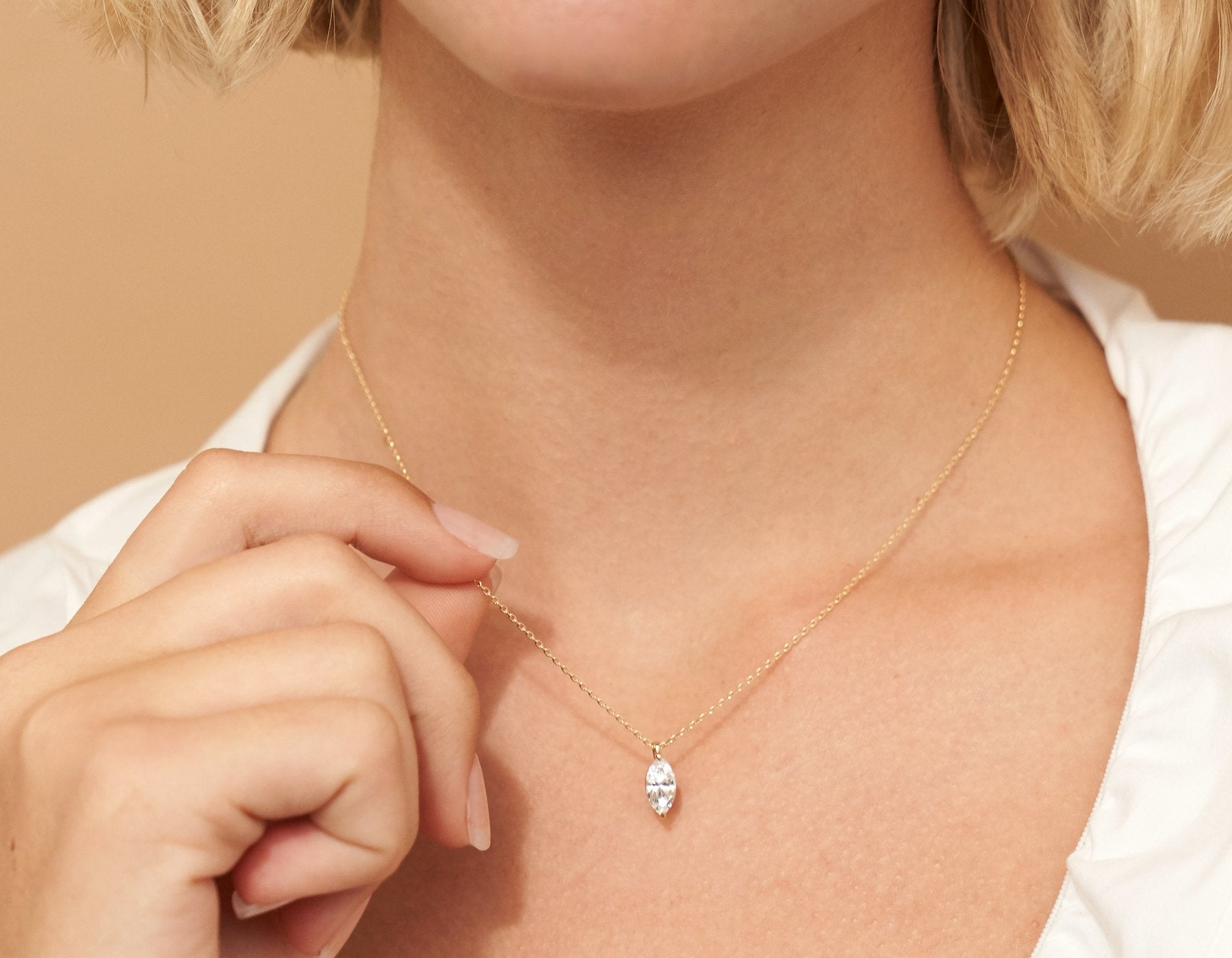 Model wearing Vrai 14K solid gold solitaire marquise diamond pendant necklace 1ct minimalist delicate, 14K Rose Gold