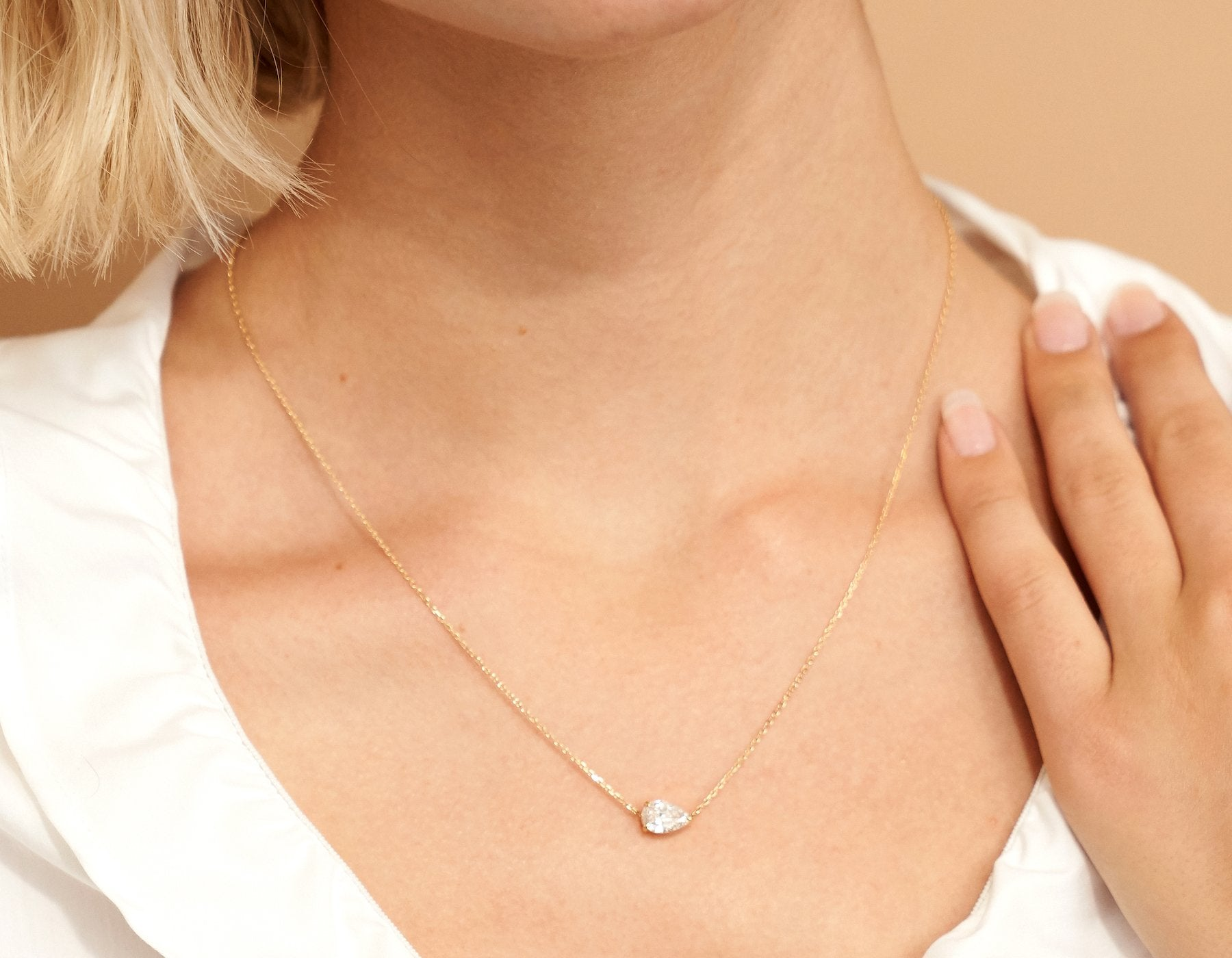 Model wearing Vrai 14K solid gold solitaire pear diamond necklace 1ct minimalist delicate, 14K Rose Gold