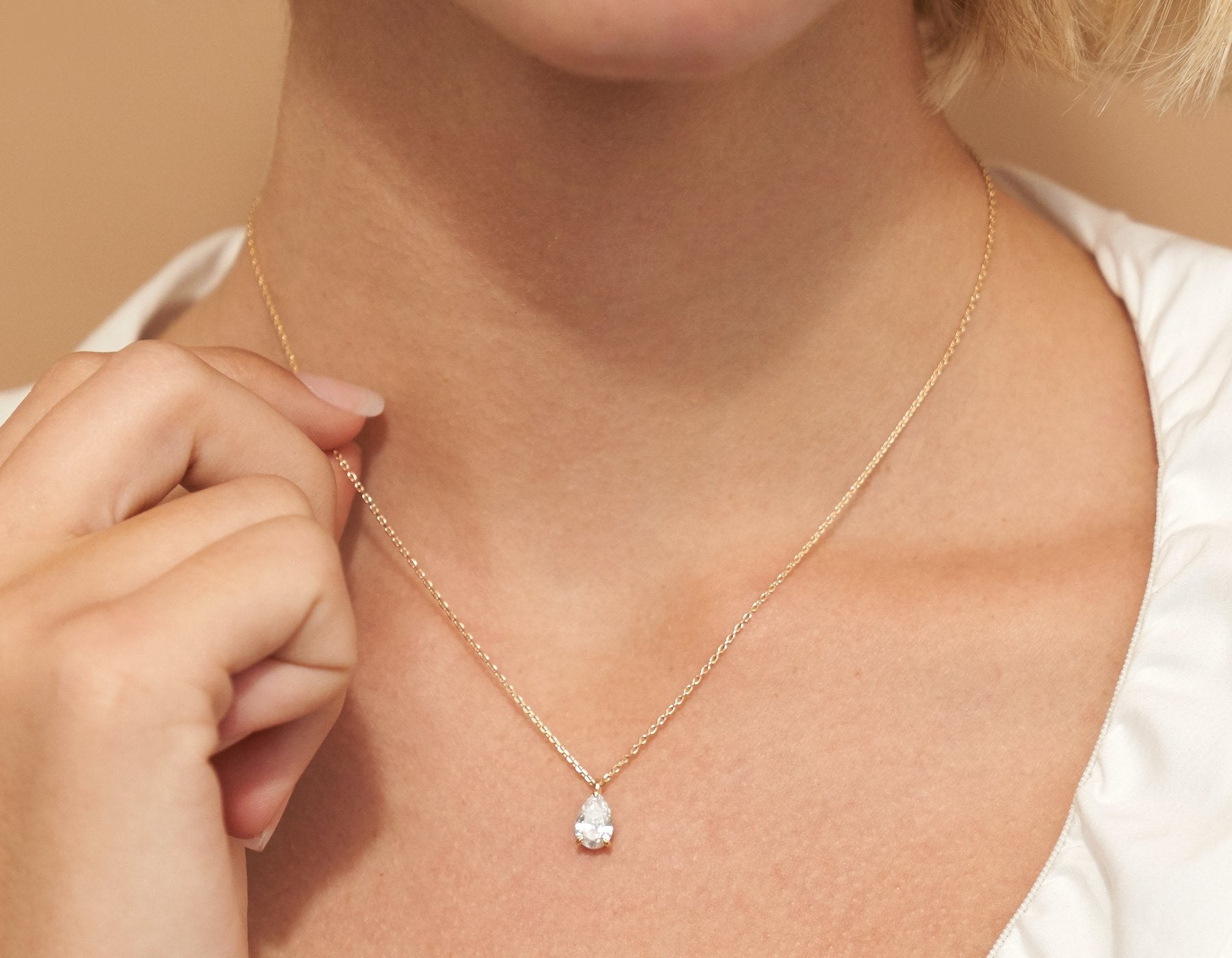 Model wearing Vrai 14K solid gold solitaire pear diamond pendant necklace 1ct minimalist delicate, 14K White Gold