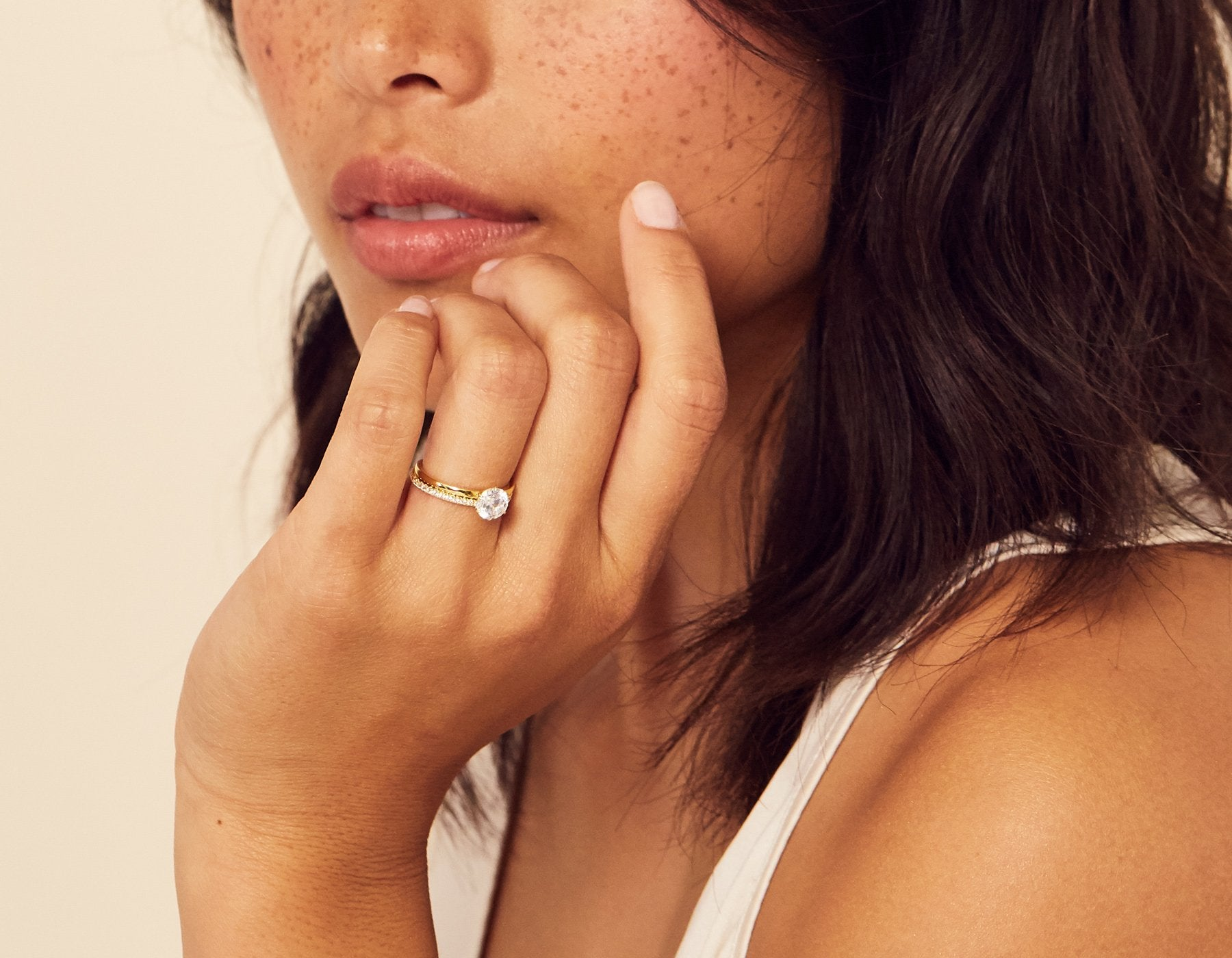 Model wearing Solitaire Diamond Engagement Ring with Infinity Wedding Band Vrai & Oro Modern minimalist Sustainable diamond foundry