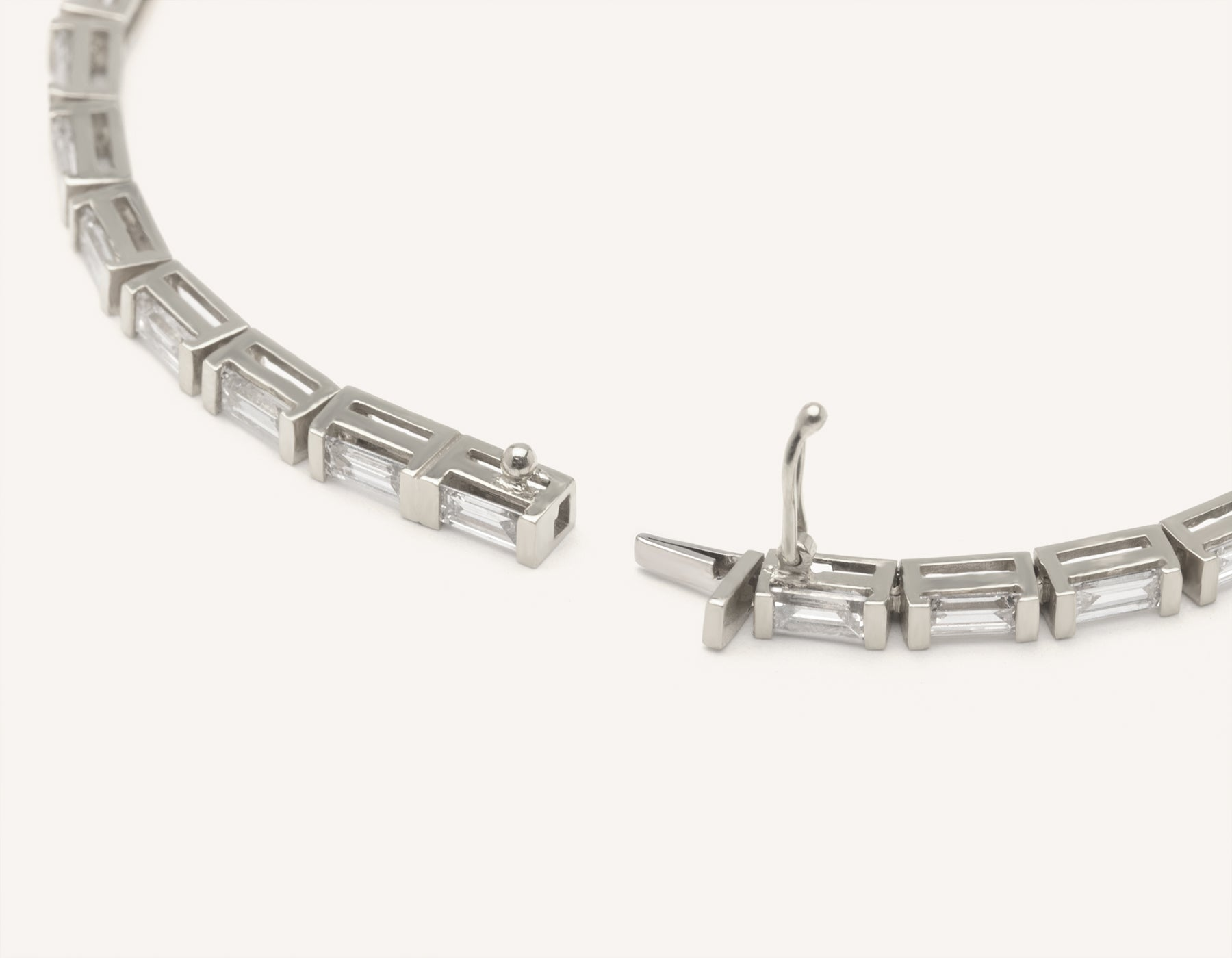 Sleek modern 18k solid gold Baguette Diamond Tennis Bracelet secure clasp handcrafted by Vrai & Oro, 18K White Gold