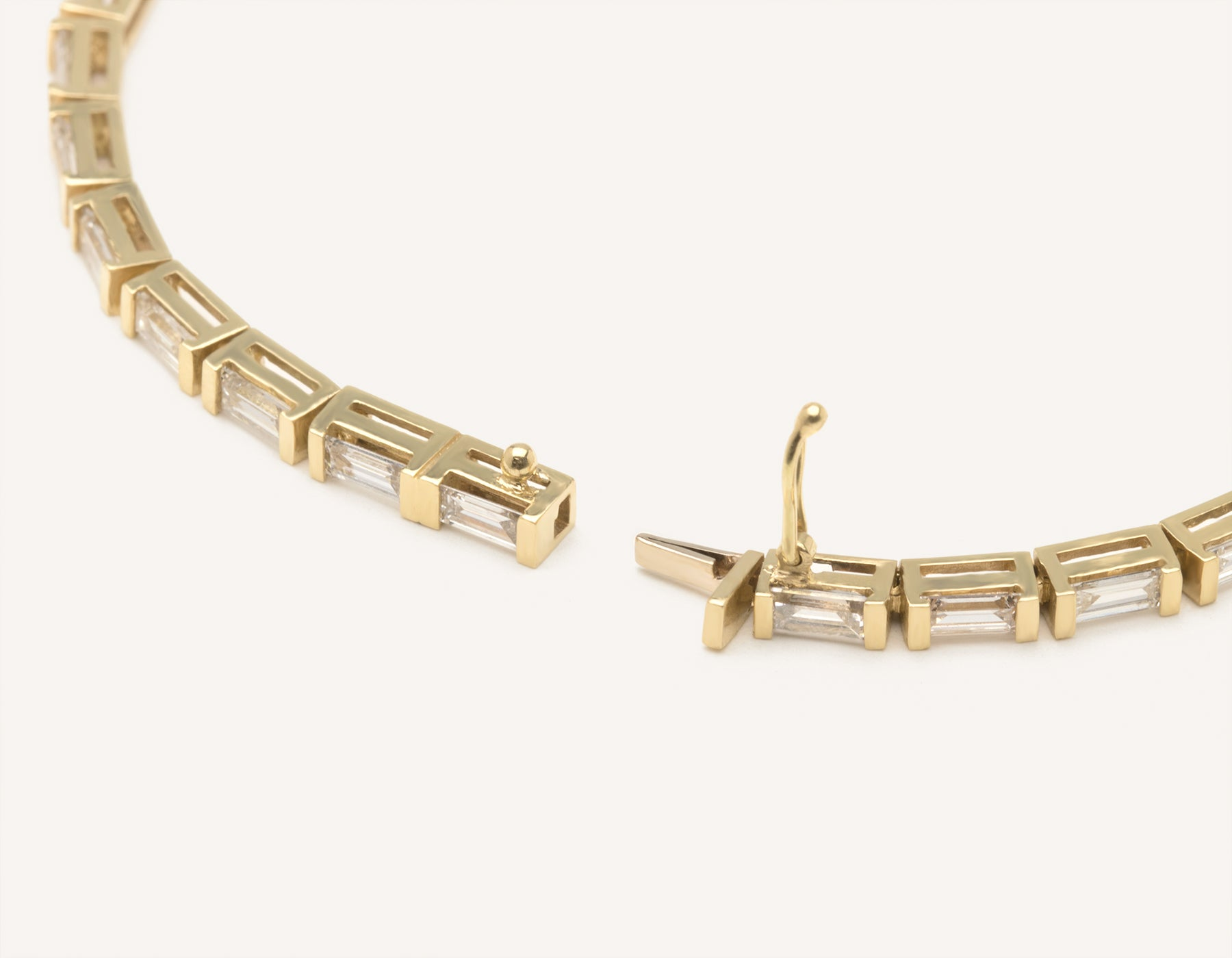 Sleek modern 18k solid gold Baguette Diamond Tennis Bracelet secure clasp handcrafted by Vrai & Oro, 18K Yellow Gold