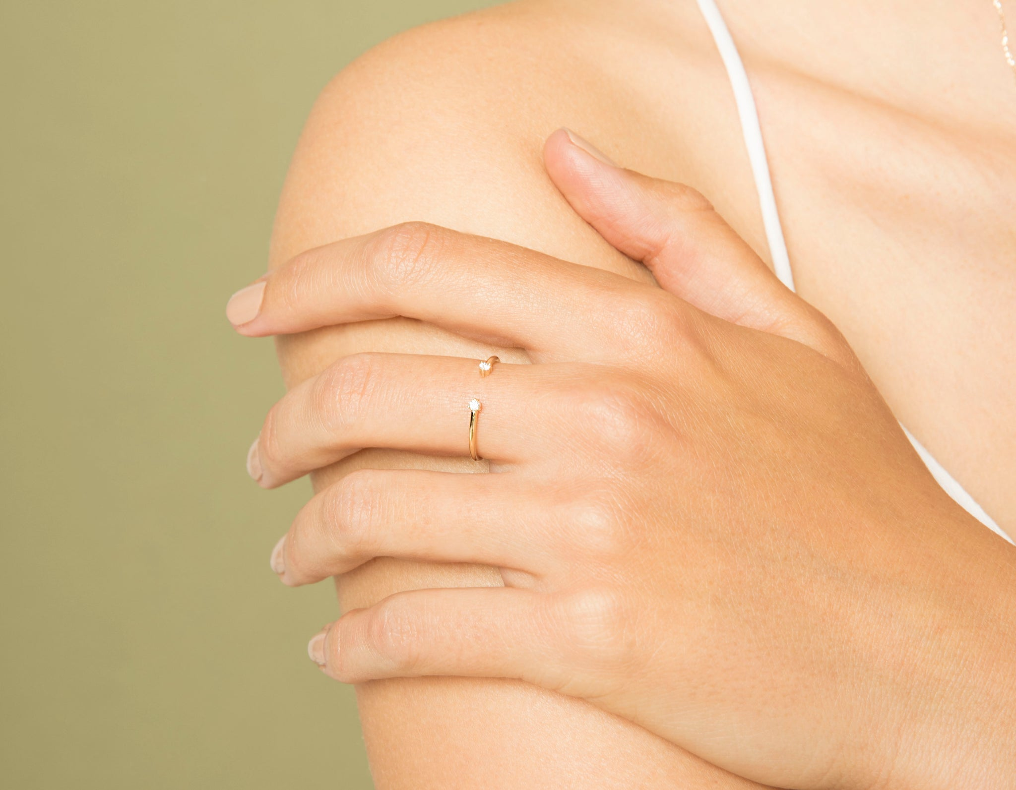 Woman modelling simple sophisticated 14k yellow gold subtle Diamond Dot Cuff ring by Vrai & Oro