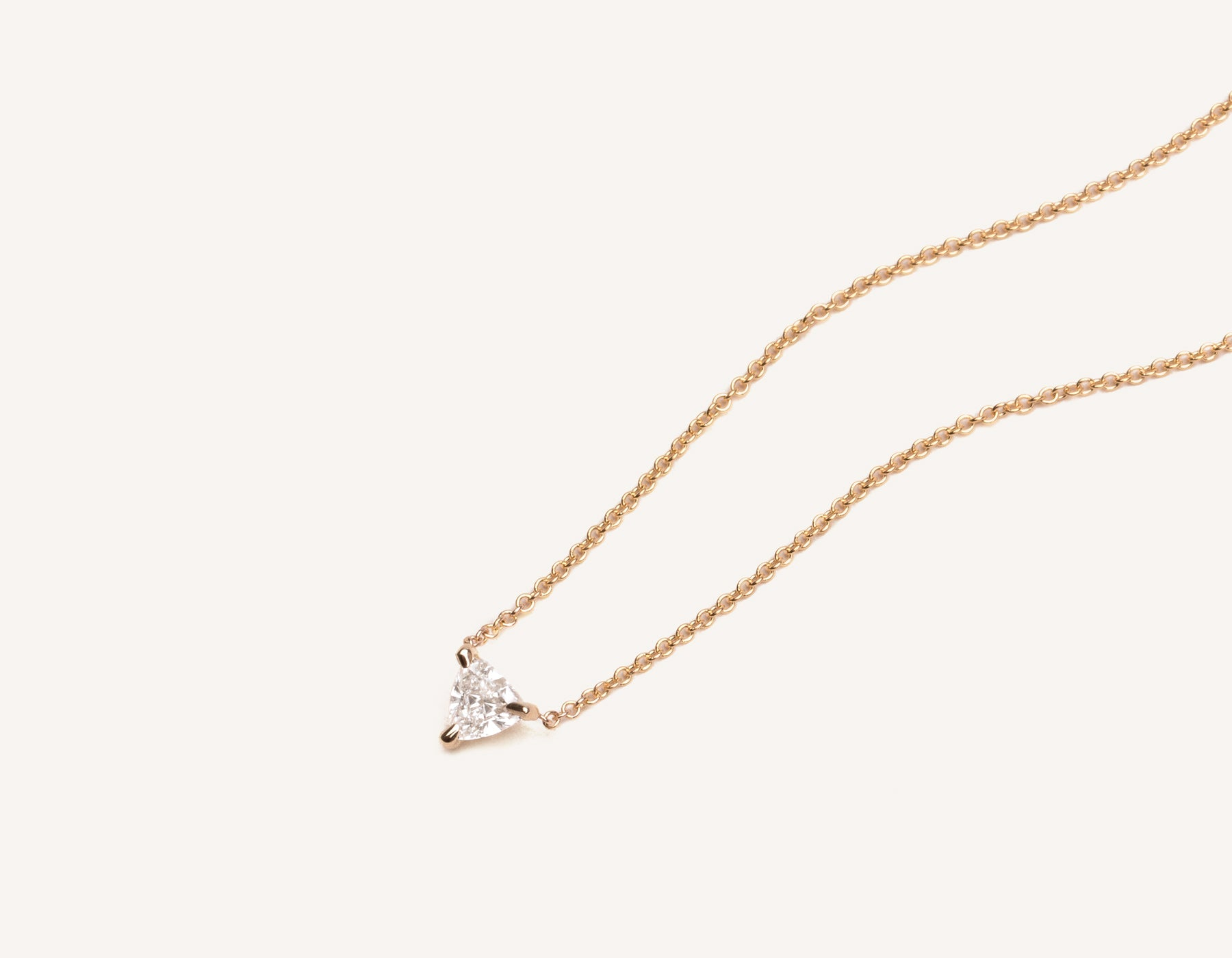 Close up of 14k solid gold Trillion Diamond Necklace with triangle diamond on simple chain by Vrai & Oro modern minimalist jewelry, 14K Rose Gold