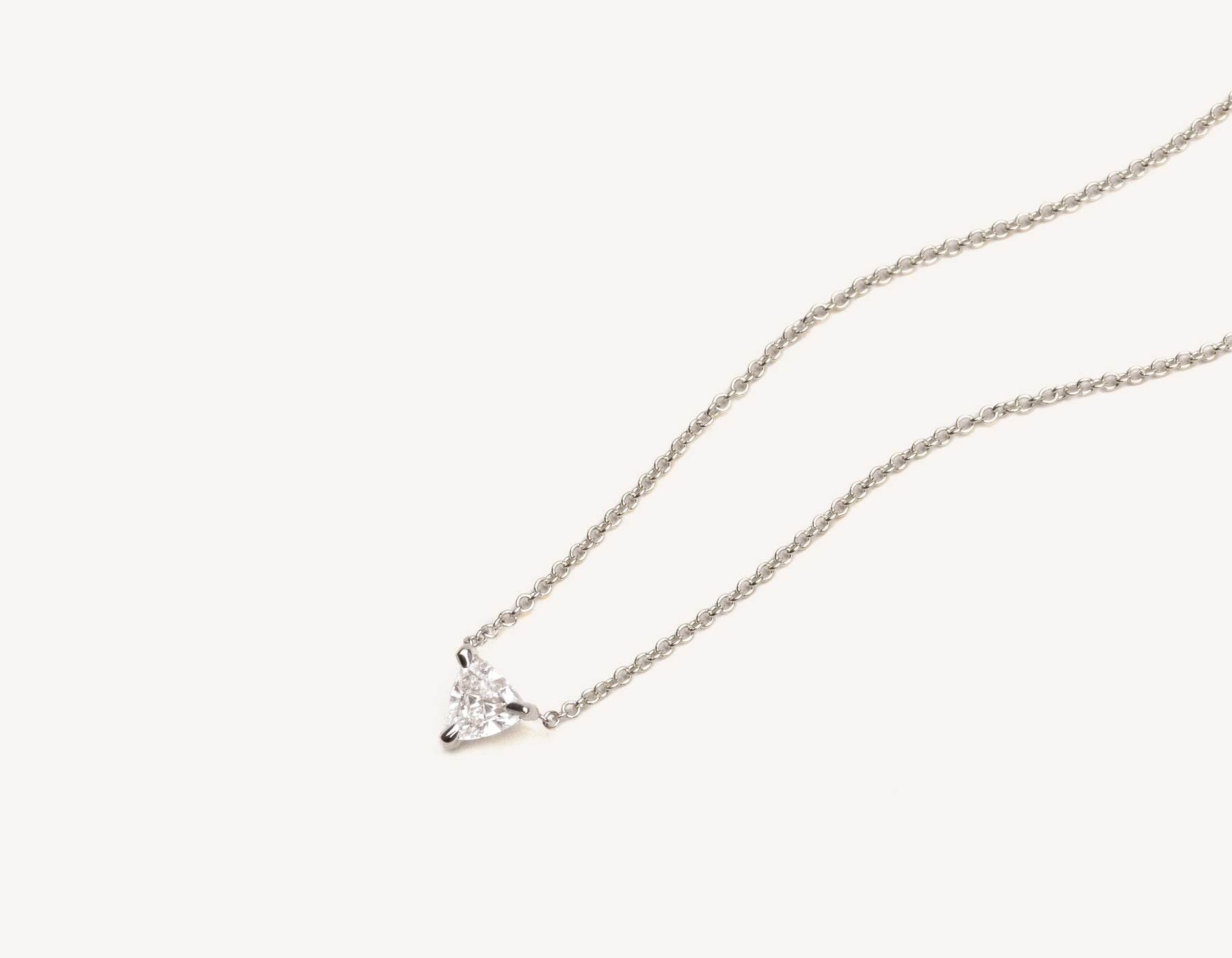 Close up of 14k solid gold Trillion Diamond Necklace with triangle diamond on simple chain by Vrai & Oro modern minimalist jewelry, 14K White Gold