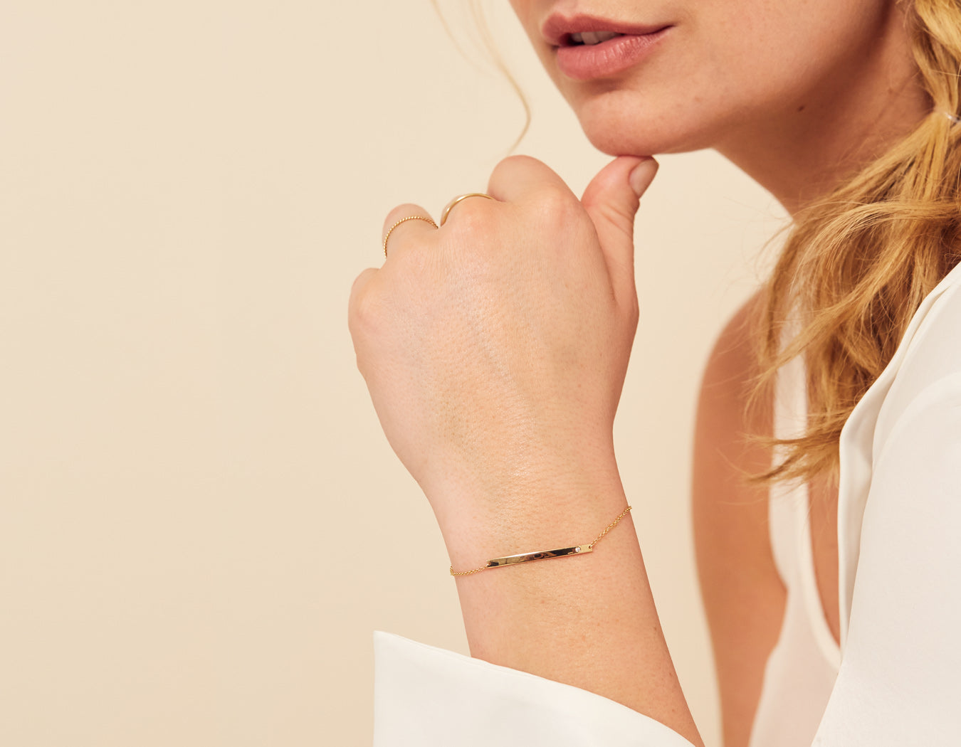Woman wearing dainty simple 14k yellow gold Bar Bracelet with Diamond by Vrai and Oro minimalist jewelry