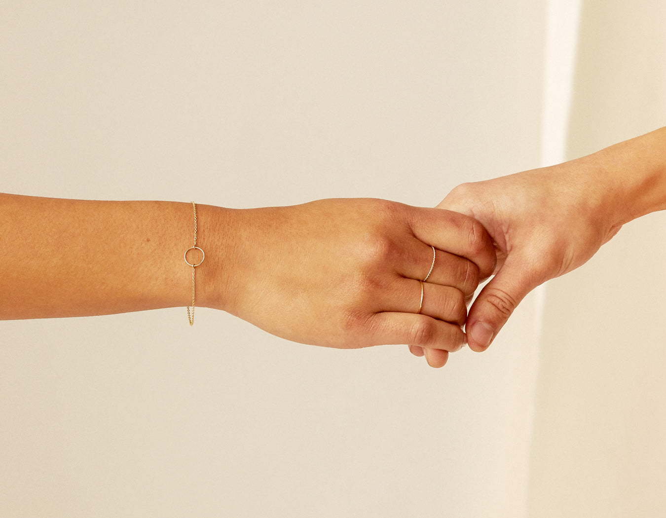 Woman modelling dainty geometric 14k solid gold Circle Bracelet by Vrai & Oro minimalist jewelry