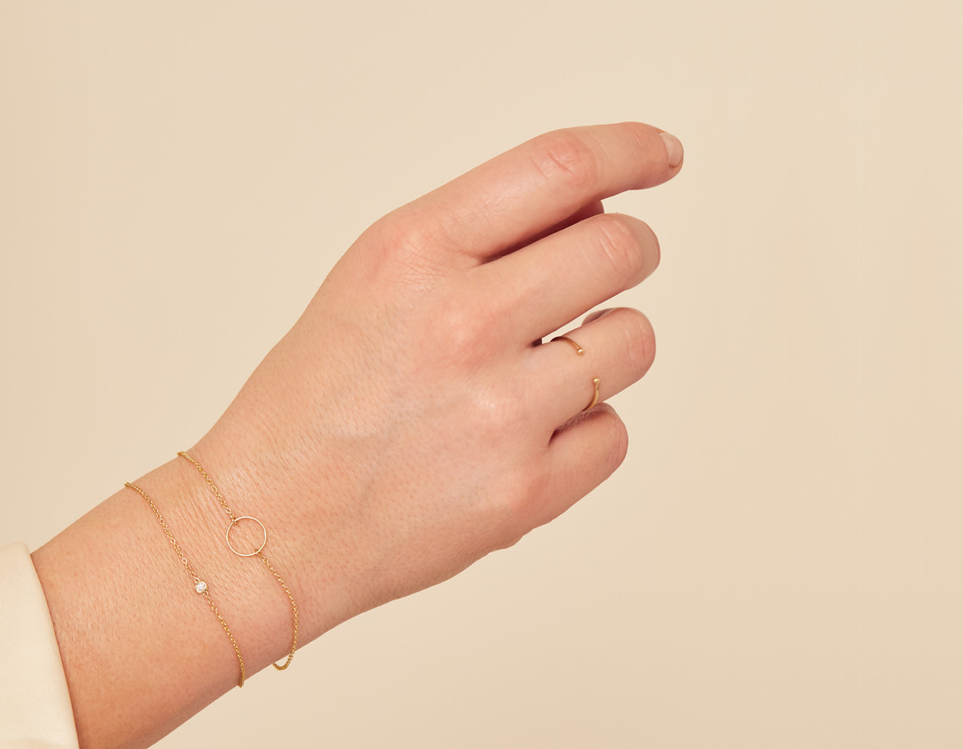 Woman wearing simple modern 14k yellow gold Circle Bracelet by Vrai and Oro
