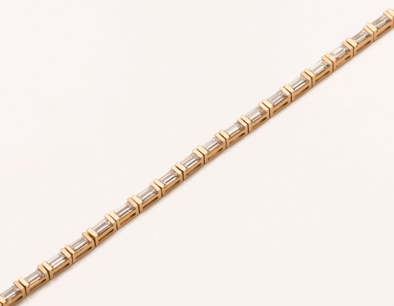 Sleek modern 18k solid gold Baguette Diamond Tennis Bracelet handcrafted by Vrai & Oro, 18K Rose Gold