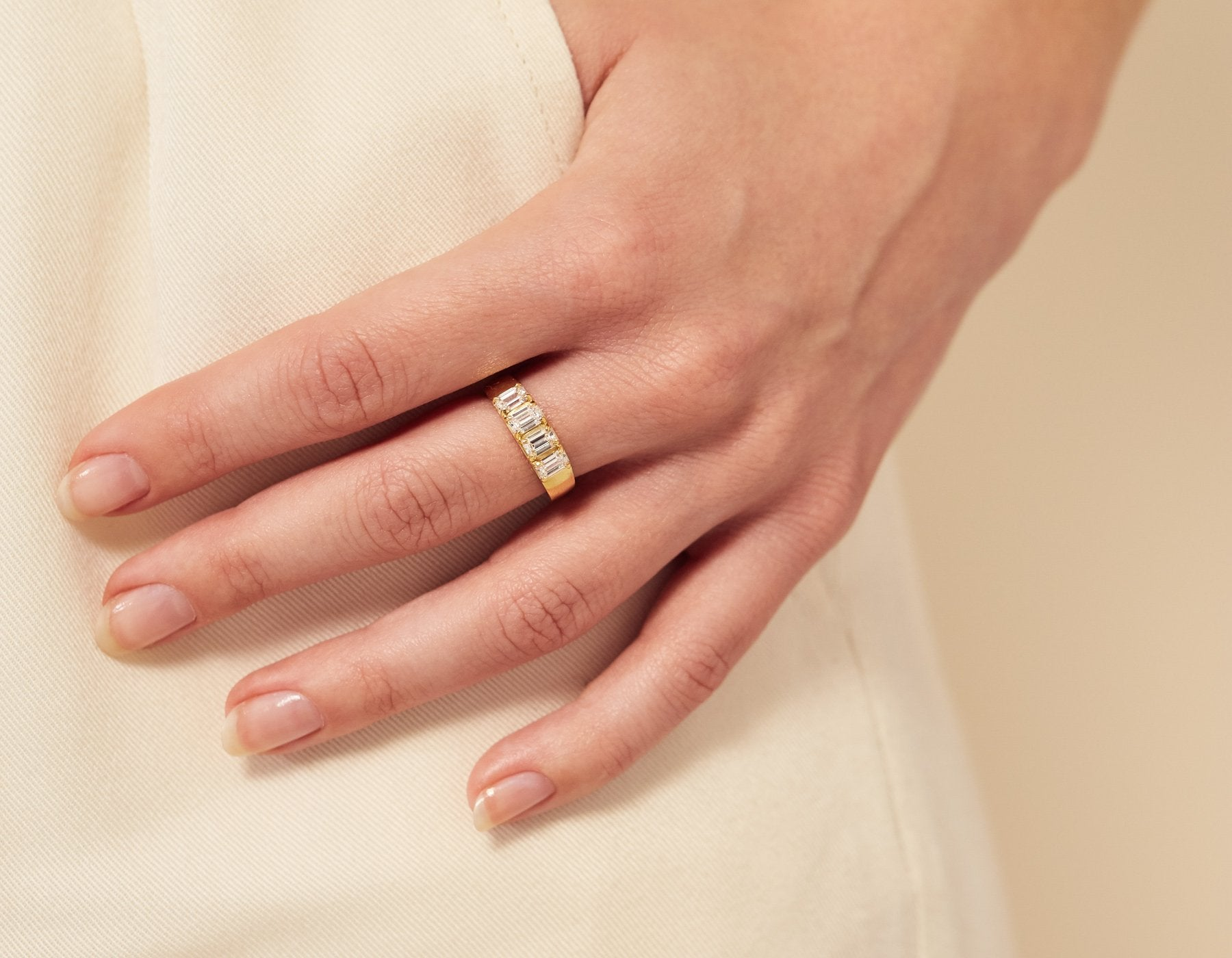 Close up Hand Model 14K Solid Yellow Gold Emerald Diamond Tetrad Band Vrai and Oro Minimalist sustainable jewelry