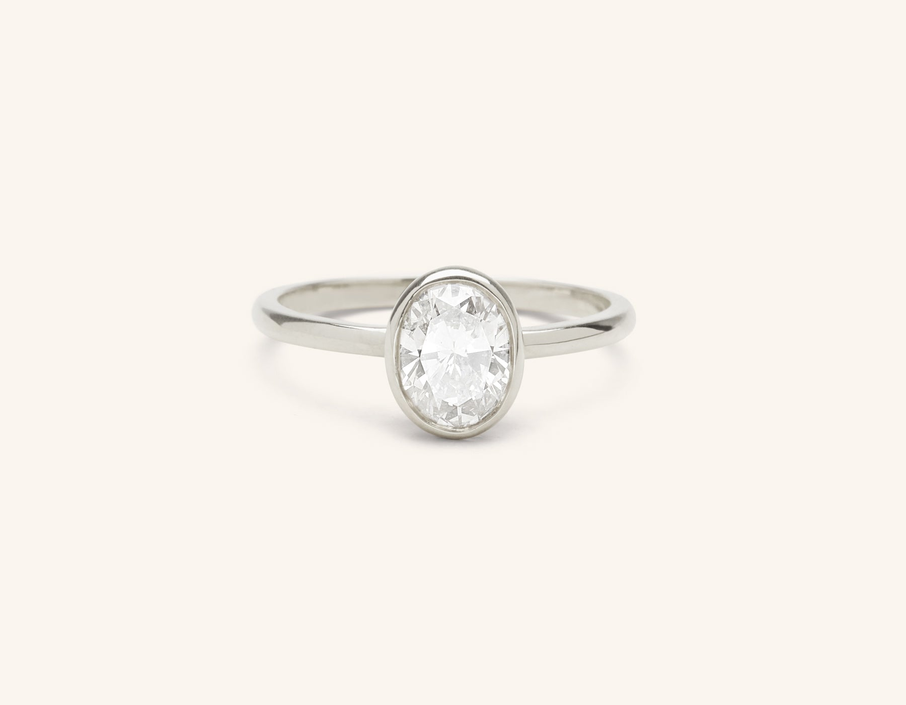 Minimalist platinum Oval Bezel engagement ring 1 ct diamond Vrai and Oro
