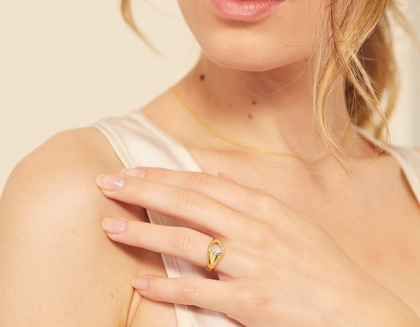 Vrai and Oro model wearing Oval Rose Signet diamond ring in 18K solid yellow gold simple classic