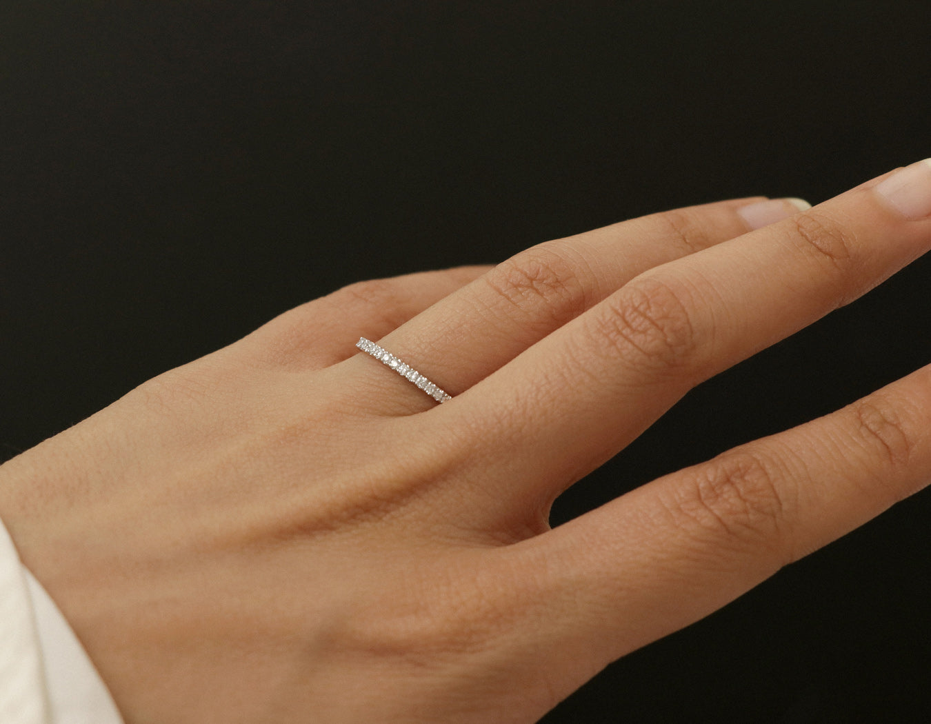 simple modern Vrai & Oro Petite Diamond Band in 14k white gold zoomed on hand