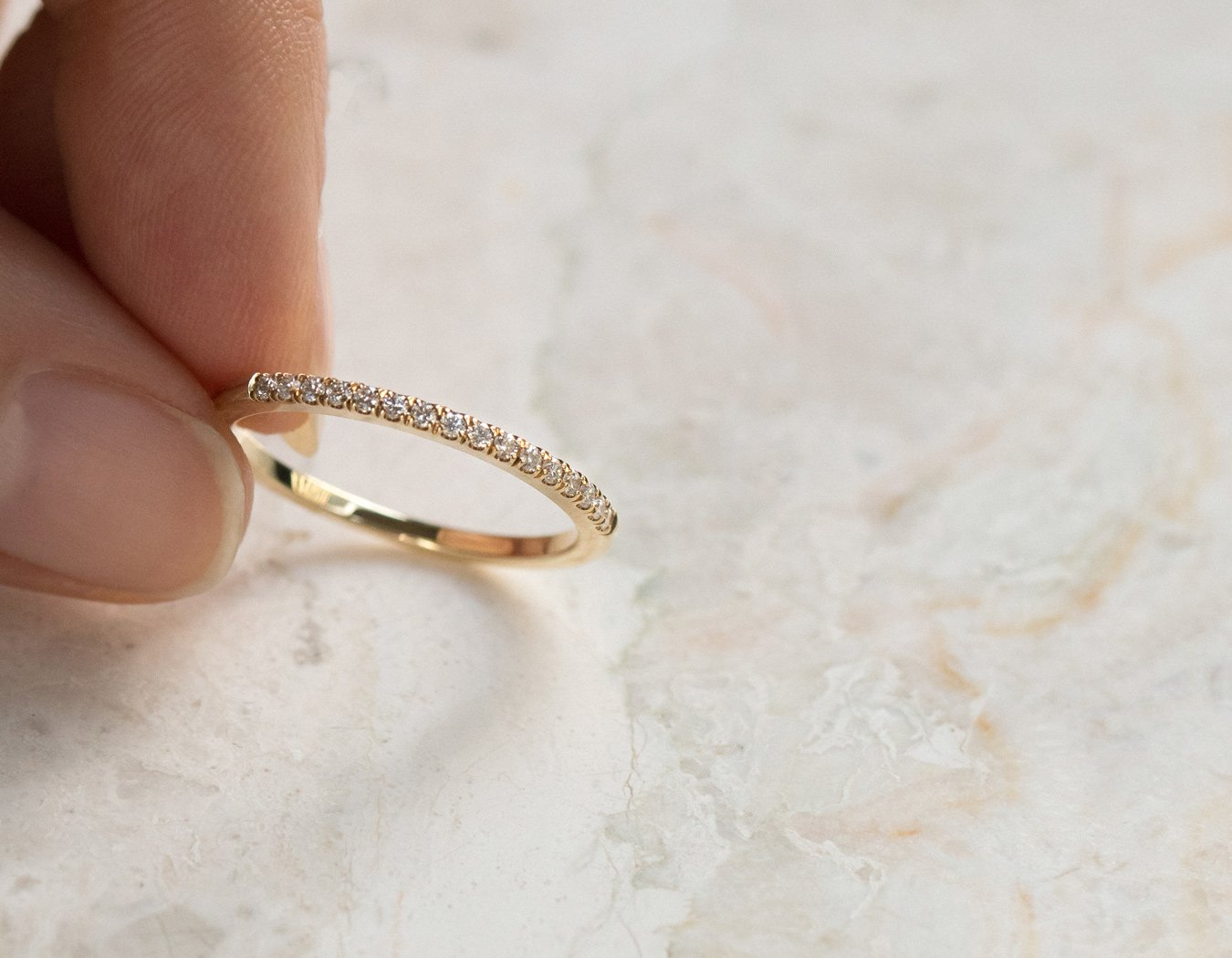 Close up Petite Diamond Band 14k yellow gold ring Vrai & Oro elegant minimalist jewelry