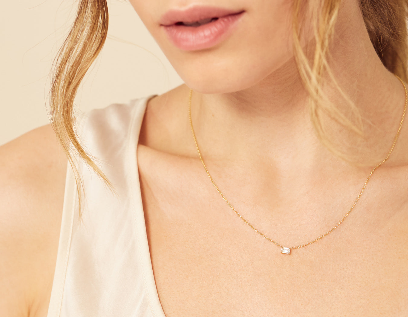 Woman modelling simple classic .25 ct Emerald Diamond necklace in 18K Solid Yellow Gold Vrai & Oro Modern Minimalist jewelry