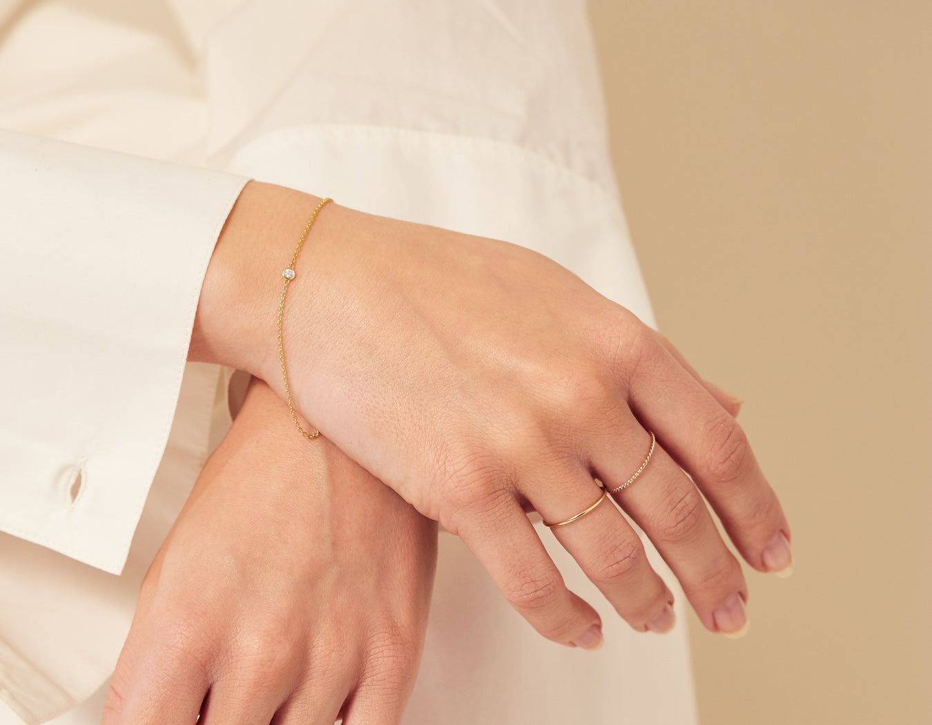 woman modelling modern minimalist Solitaire Bracelet delicate chain lobster clasp 14k yellow gold .04 ct round diamond Vrai and Oro