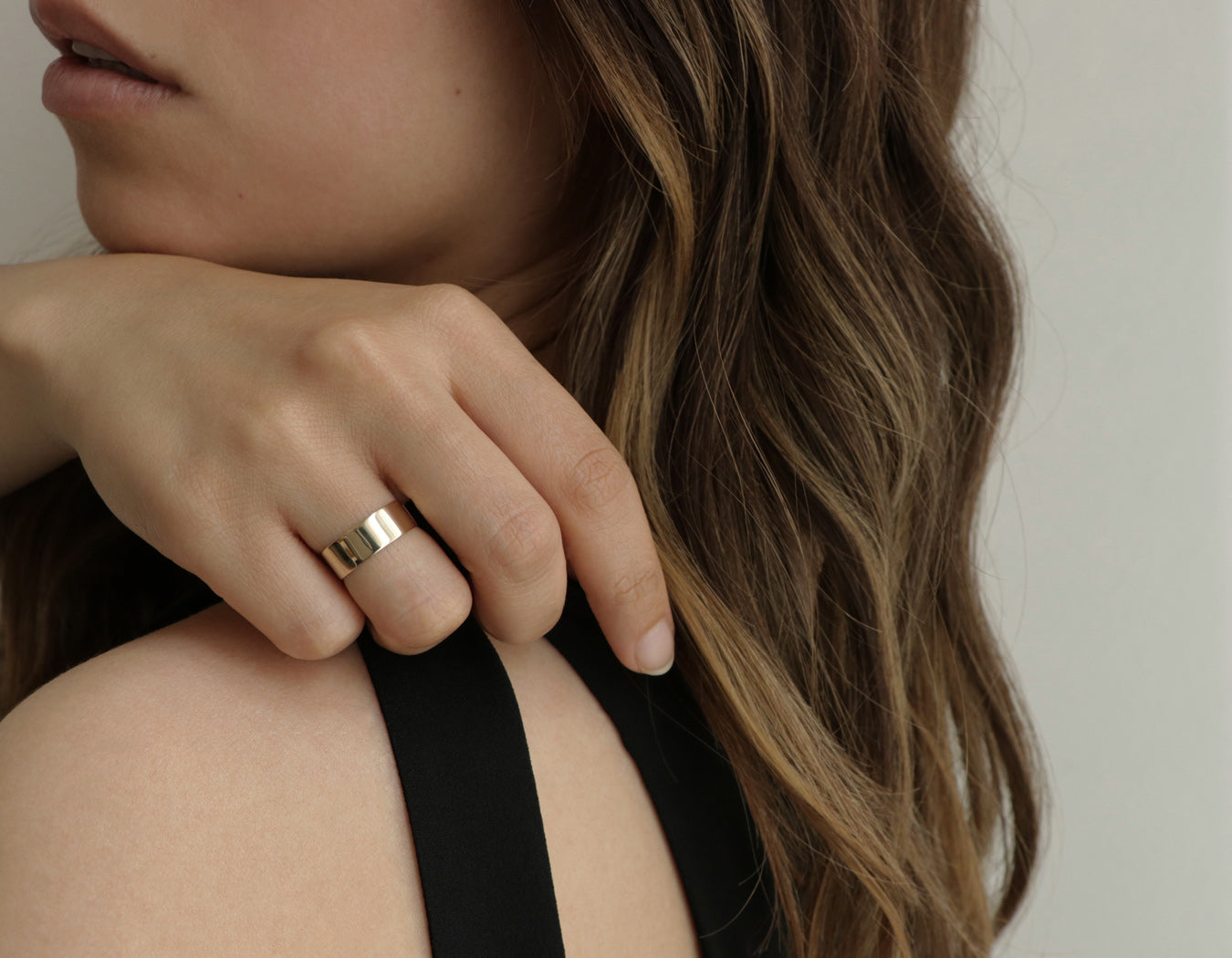 Model wearing Thick Stacker Ring 14k solid yellow gold geometric minimalist band