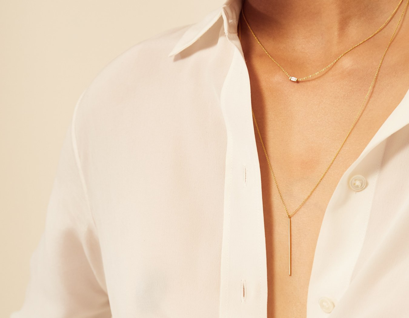Vrai and oro modern minimalist 14k solid gold long chain Vertical Bar Necklace paired with short chain baguette diamond necklace