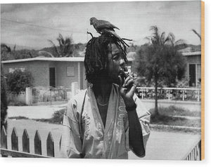 Peter Tosh In in his Yard Burning A Spliff with His Parrot Freddie - Wood Print
