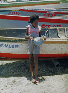 Girl By Boats on Beach In Jamaica - Art Print