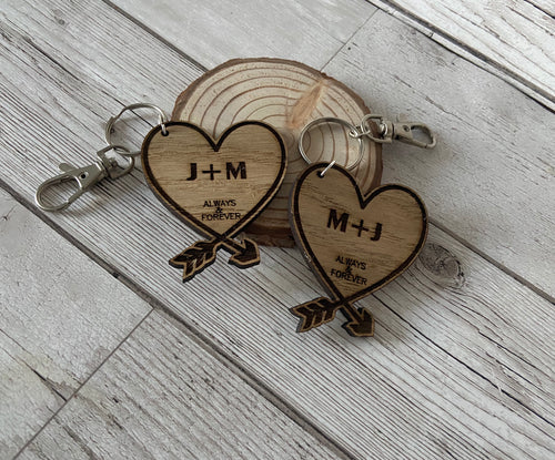 A pair of Heart Keyrings Personalised with Initials - Laser LLama Designs Ltd
