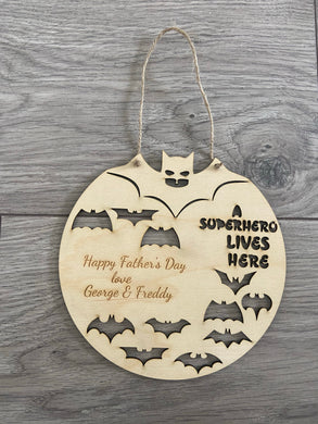 A superhero lives here wooden plaque